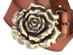 A belt buckle for the cowgirl or cowboy who need that special scent on the trail